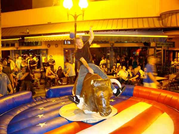 Mechanical bull riding at Wall Street Plaza