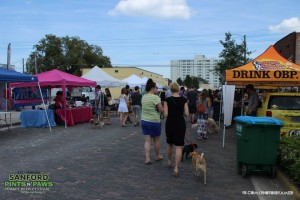 People Walking the Street at Pints n' Paws in Sanford