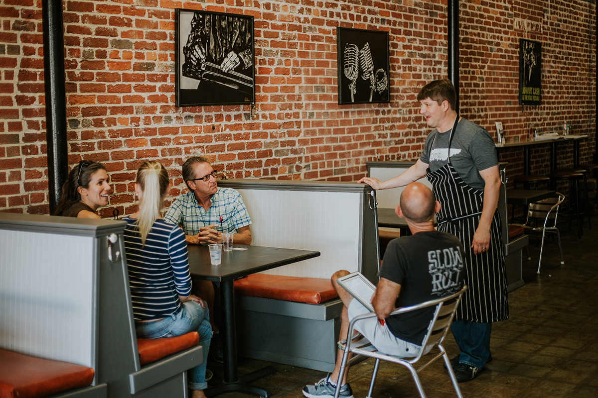 Meeting the restaurant owners during one of the fabulous Sanford Food Tours