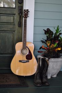 A guitar on a porch that will be featured at Sanford Porchfest